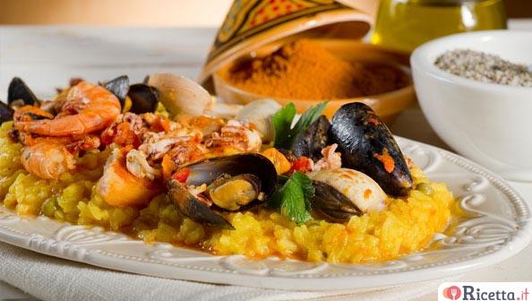Ricetta paella di pesce for Pesce rosso costo